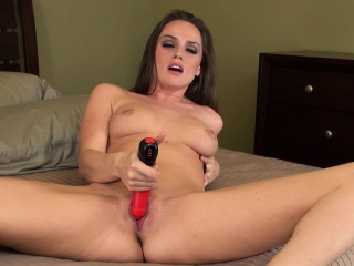 beautiful brunette tori black takes herself to climax with a red dildo