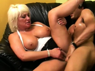 voluptuous blonde cougar has a younger guy pounding her hairy beaver