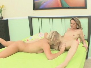 Sexy blondes shove in a dildo while they...