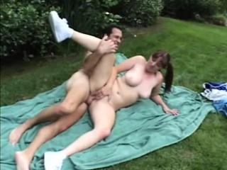 busty brunette cheerleader with braids enjoys a deep slam outdoors