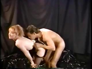 Classic star redhead Flame munches on the long dong of Jeff Stryker