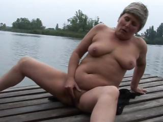 Porn Tube of Granny Is Masturbating Outdoors