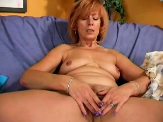 fiery redhead milf with big boobs drills her snatch with a long dildo