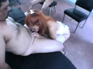 redhead fingers herself and blows a cock while others wait their turn