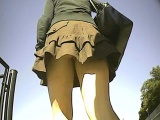 chick is followed around by a spy cam with a great upskirt