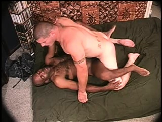 interracial gay bears take turns fucking each other's asses on the bed