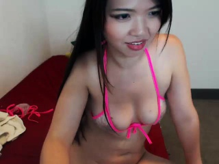 Hot Asian girl spreads her sexy legs and displays her sweet