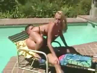 Porno Video of Petite Blonde Has An Anal Obsession And Likes His Cock By The Pool