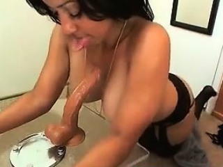 Ebony suck stick dildo