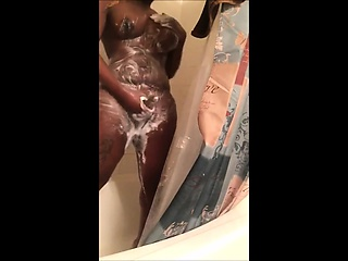 Ebony busty shemale with big fat cock