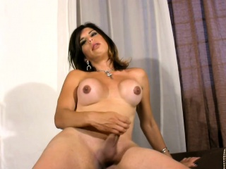 kinky tranny touches her round breasts and shaved ladystick