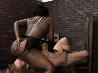 ebony mistress queening sub in sexdungeon