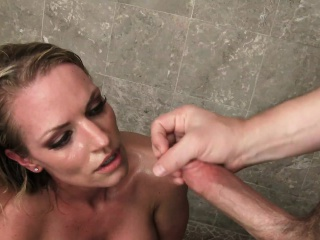 sultry blonde cougar with big boobs fucks a young stud in the shower