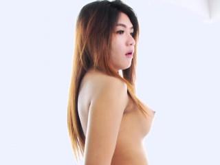 Adorable Asian shemale Yoghurt jerking off in her bedroom