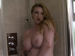 busty inked slut shows off her body