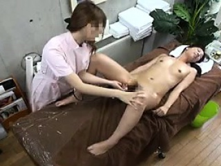 sexy slim japanese babe has a masseuse taking her wet peach