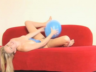 allie plays naughtily with a balloon