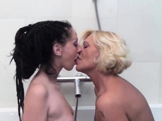 two naughty bitches have bathroom sex