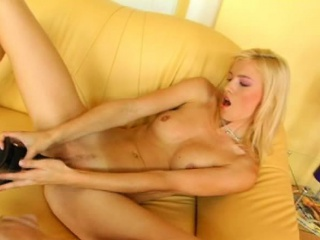 margareth playing with a massive dildo
