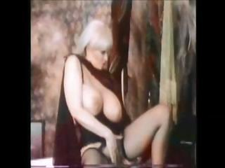 Candy Samples is one of vintage porns big-breast queens and she gets it on with this young guy