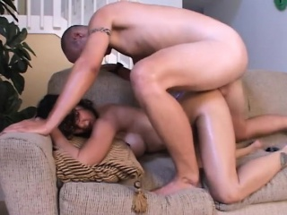 alluring brunette has a hung guy plowing her shaved pussy doggy style