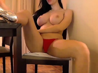 this busty brunette shows her pussy and tits while smoking a