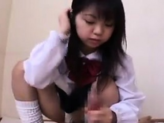 beautiful oriental schoolgirl puts her gifted hands to work