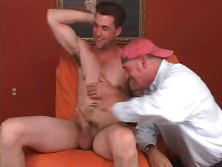 Gay dude in a ball cap is sucking cock and licking this dudes ass