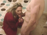 mature blonde gives a double blowjob