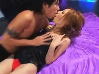 An amateur redhead lesbian is eating pussy from a brunette
