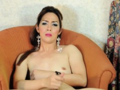 Mature asian tranny tugs on her dong