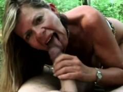 A lusty brunette mature woman sucks horny man