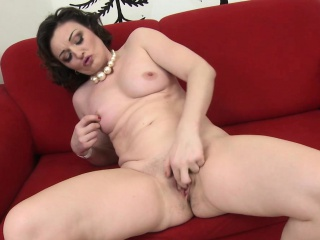 petite brunette with mature tits toying her pussy