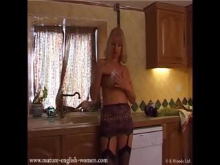 Mature English Milf gets soapy in the kitchen