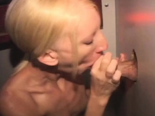 dirty blonde amateur taking cumshot through a glory hole