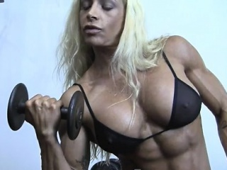 sexy blonde woman bodybuilder in seeing through works up works