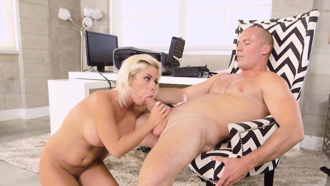 Sara Gives A Blowjob To A Guy While Her Husband Sits