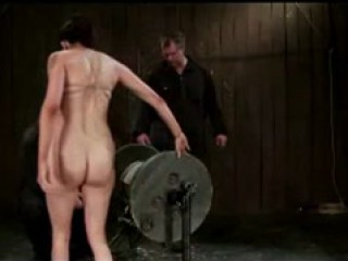 Tied To Wood Wheel Whipped And Fucked
