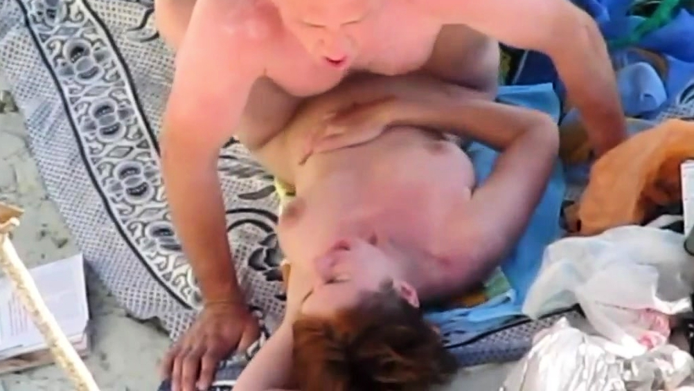Bald Man Abd Red-Breasted Wife Fuck On The Beach