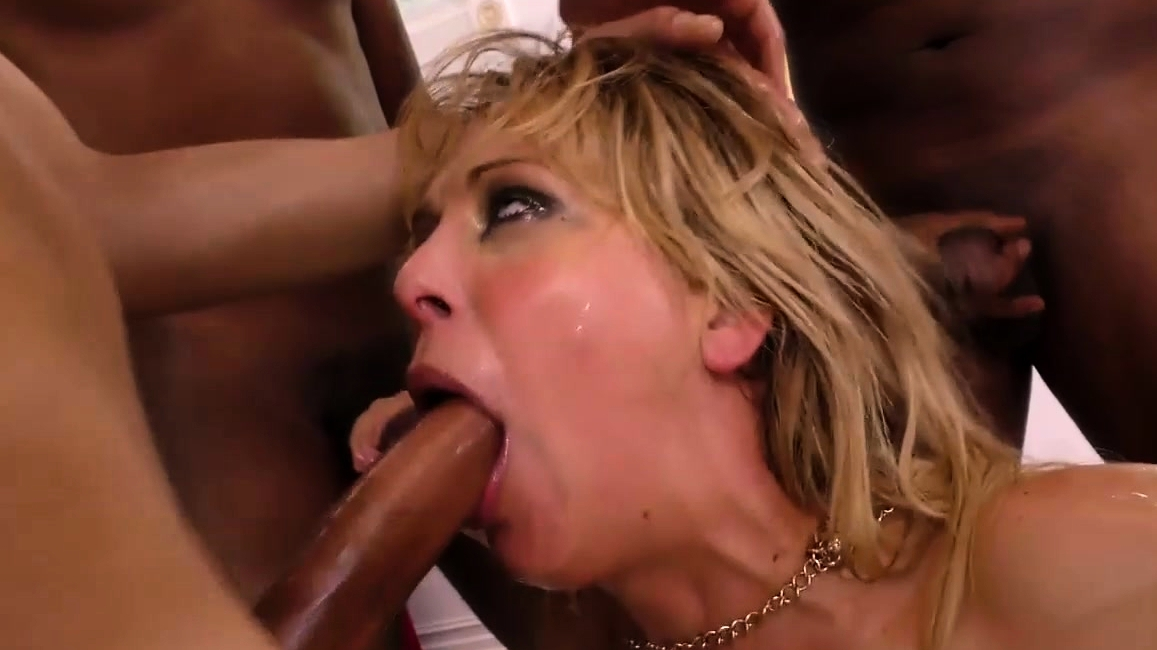 Cherie Deville Gives A Blowjob To A Group Of Black