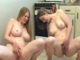 two lesbo big naturals pee together .avi