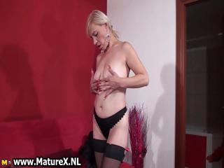 Blonde mature mom in stockings showing part1