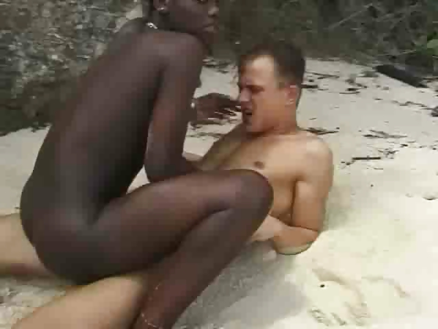 Porn Tube of Hairy African Girl Fuckin Euro Guy In Beach