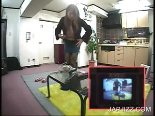 Asian babe stripping on TV