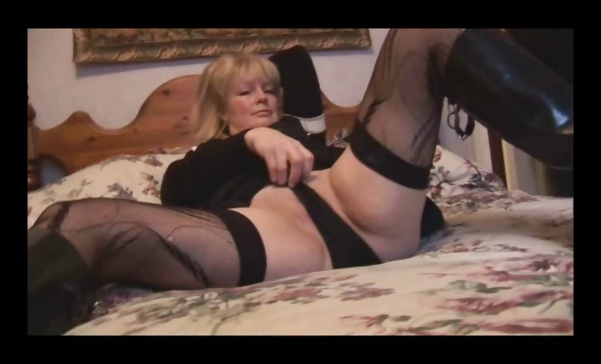 Porn Tube of Mature Busty Blonde Babe In Stockings And Mini Skirt Striptease