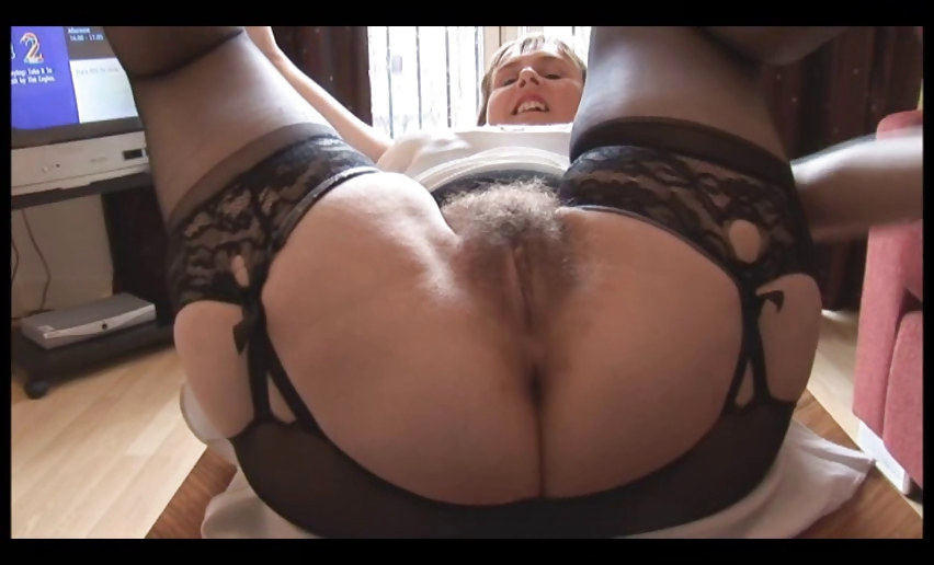 Porn Tube of Hairy Busty Mature Lady In Slip And Girdle Does Upskirt And Striptease Show