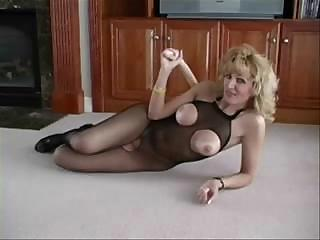Porno Video of Milf Racquel Black Body Suit High Heels Facial