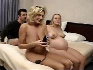 Porno Video of Two Pregnant Females Are Having Some Nice Time Together On The Bed