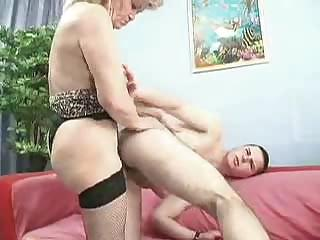 Sex Movie of Experimenting Old Lady Fucks Young Male`s Ass With Red Strap-on