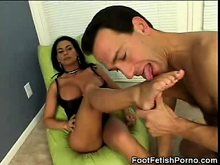 Busty MILF Gives a Foot Job
